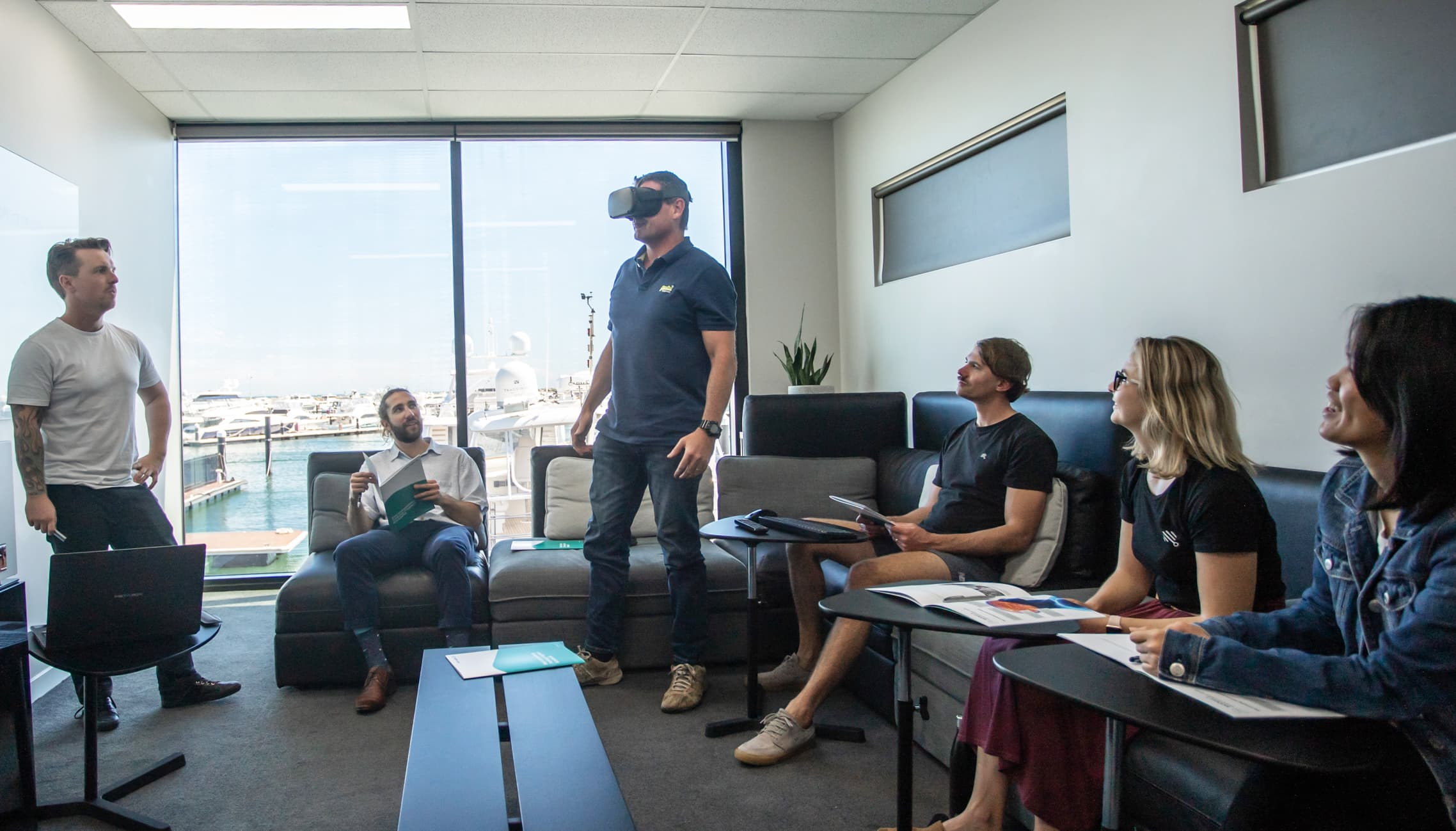 group of people in a VR company learning the pros and cons of vr training